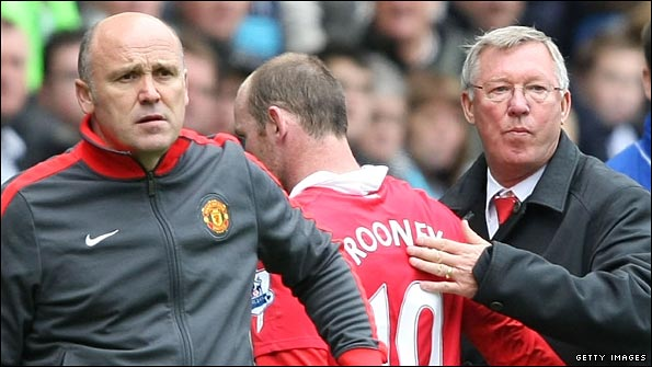 Wayne Rooney gets a pat on the back from Sir Alex Ferguson