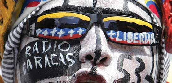 An RCTV sympathiser with painted face demonstrates against Chávez's decision not to renew the TV station's licence. Photo credit: Reuters