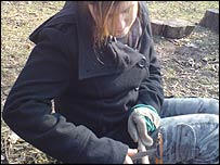A girl carves with a knife