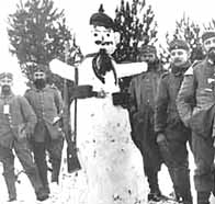 A group of German soldiers around a Christmas snowman