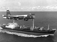 A P2V Neptune US patrol plane flying over a Soviet freighter during the Cuban missile crisis, 1962