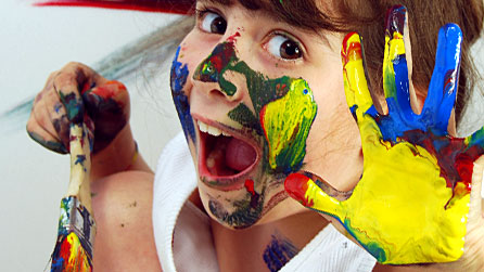 Photograph of a young girl covered in paint. Image from iStockPhoto.com, posed by model.