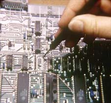 Printed circuit board being checked after manufacture