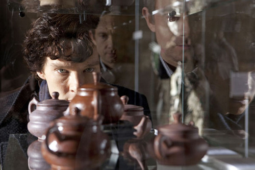 Sherlock Holmes, played by Benedict Cumberbatch, peers through a window