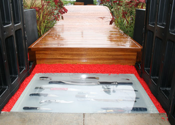 Knives confiscated by police set into resin blocks