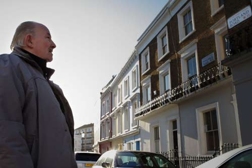 George Andrews looks up at a row of terraced houses in Portland Road