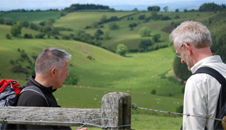 Jim and Derek crossing over a stile