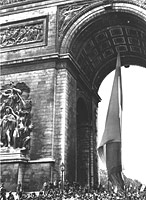 The Tricolore being carried underneath the Arc de Triomphe, August 1944