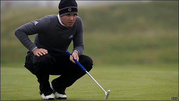 Martin Laird sizes up a putt during the Dunhill Links at St Andrews