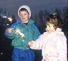 Photograph showing two kids holding sparklers