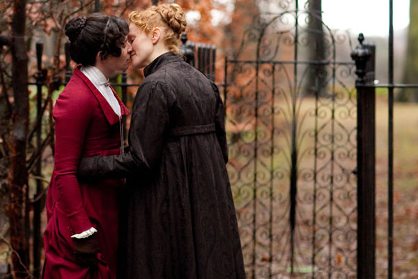 Anne Lister, played by Maxine Peake, and Tib, played by Susan Lynch share a kiss outside some gates