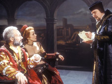 Claudius and Gertrude listen to Polonius read out a letter, a still from the 1980 BBC adaptation of Hamlet