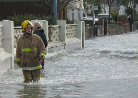 Firefighters deal with flooding and damage
