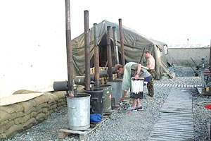Back to basics. The British peace-keepers have to collect their washing water from these tanks