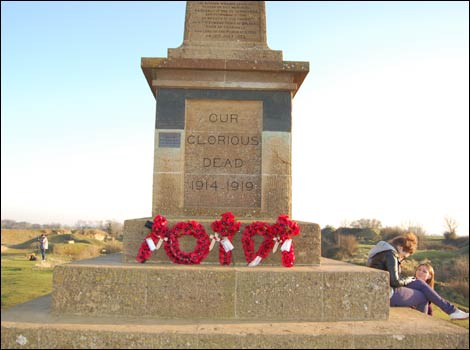 Poppies on the war memorial at Ham Hill