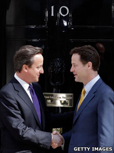 David Cameron and Nick Clegg outside the door of 10 Downing Street