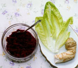 Bowl of dark red paste, romaine lettuce and horseradish root