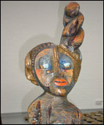 Lilian Nabulime's carving of a headwrapped woman