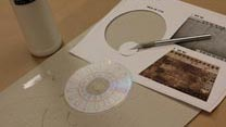 Cut out armature disk and glue ink-side-down in the centre of the CD protector