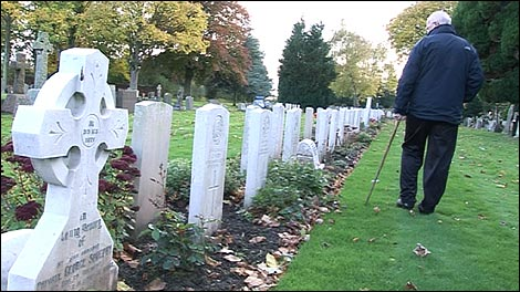 Ian looking at the war graves in Carlisle Cemetery