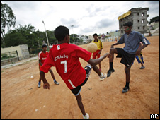 Boys playing football in India