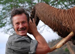 Jonathan Scott with orphaned elephant in Tsavo ©Toby Strong