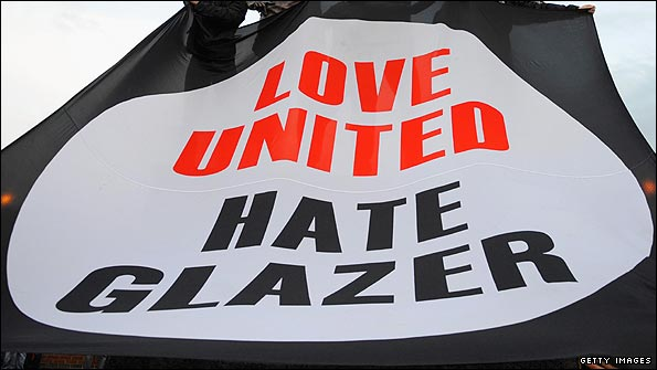 Manchester United fans with a banner protesting against the Glazers