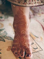 Bride's feet decorated with henna