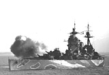 HMS 'Rodney' shells Caen prior to the attack, July 1944