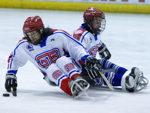 Two players tussle for the puck. Taken by On Edition Photography