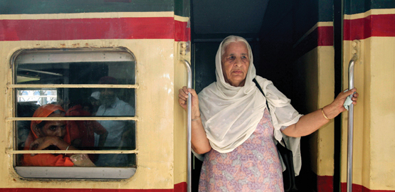 Amritsar, India - an elderly Sikh woman boards a train. Photo credit: AP
