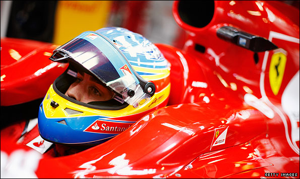 Fernando Alonso at the cockpit of his Ferrari