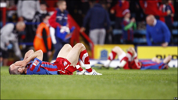 Crystal Palace players show their frustration after failing to defeat West Brom.