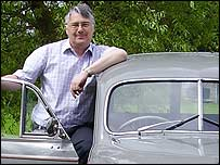 David Clayton with a Morris Minor Traveller