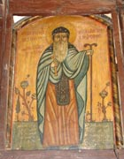 Religious icon of St Macarius among plants and carrying a tall two-headed staff