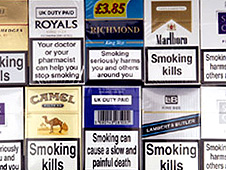 "cigarette packets with warnings such as ""Smoking kills"" and ""Smoking seriously harms you and others around you"""