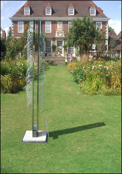 Modern sculputre contrasted nicely with traditional gardening