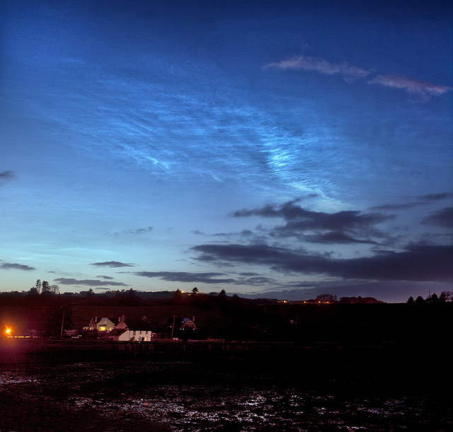 Noctilucent Clouds in the Wake of the Eclipse