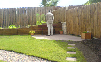 John Inspects The Veg Bed From New Patio Area