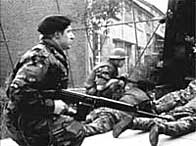Soldiers dive for cover as Provisional IRA gunmen open fire in the Lenadoon estate