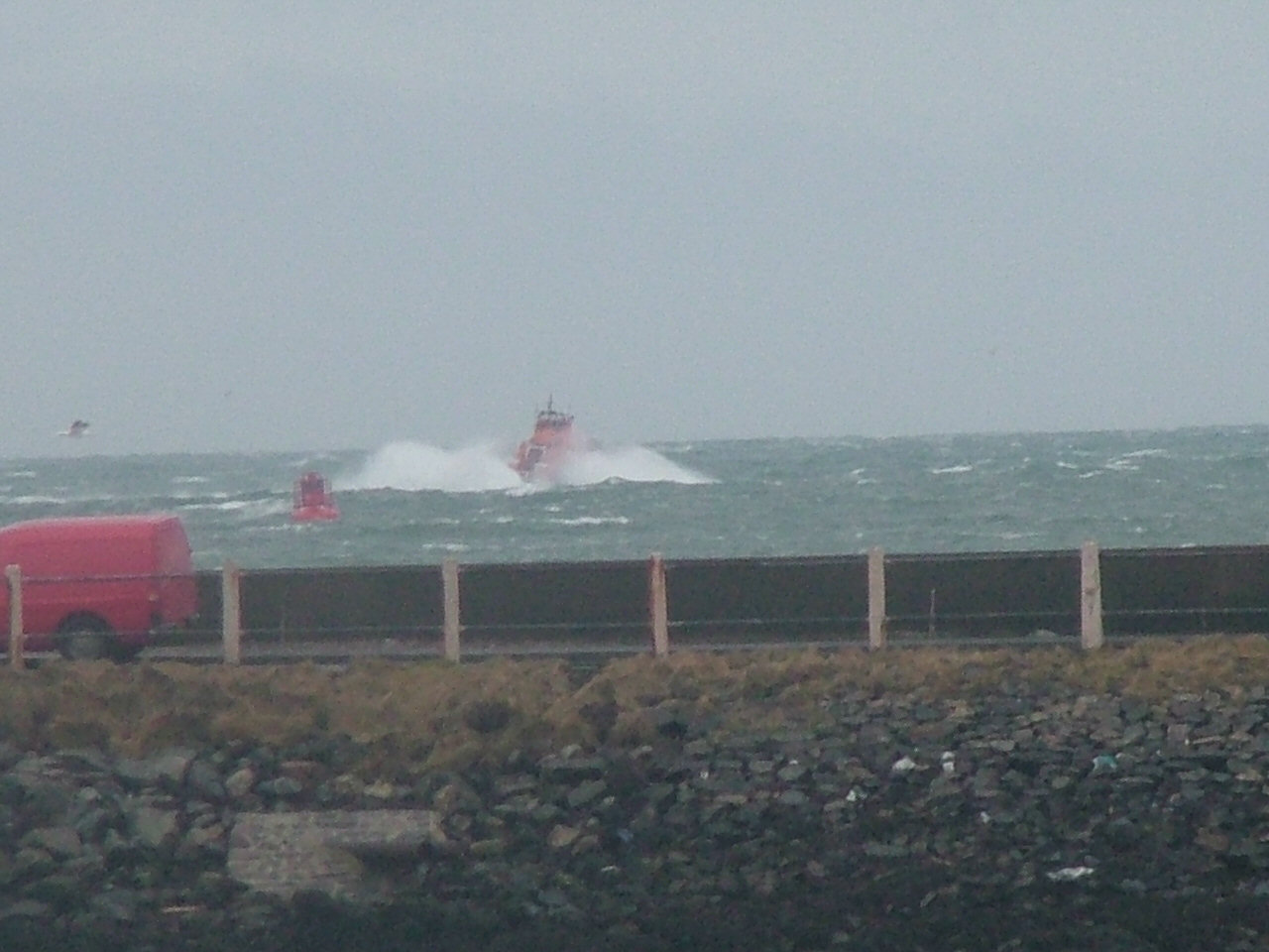Lifeboat encountering heavy seas at the Arnish Point bar