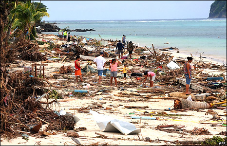 Survivors search for bodies amongst the debris left by the tsanami on Lalomanu Beach on the south coast of Samoa