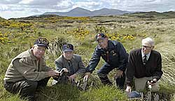 4 of the GI tank battalion rediscovering old tank-tracks - possibly their own - in Co. Down