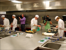Camera crews follow John and David as they prepare their dishes in the kitchens at Newcastle College