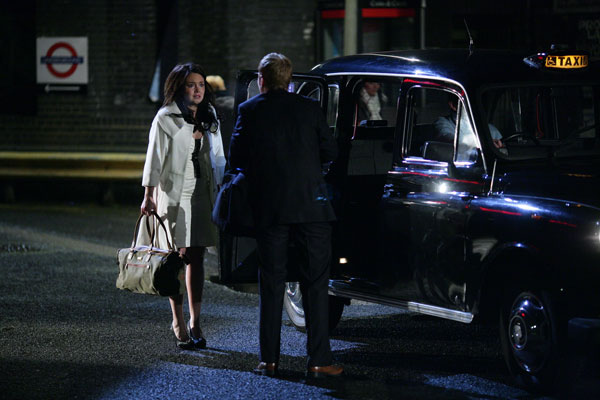 Bradley Branning and Stacey Slater attempt to escape police in a taxi in the Who Killed Archie episode of EastEnders