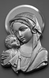 Mary and the baby Jesus depicted in metal relief