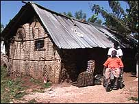 Hut and man in wheelchair
