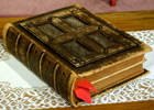 Old leather-bound Bible with ribbons marking pages
