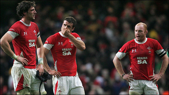 Luke Charteris, Jamie Roberts and Martyn Williams look glum after Wales are beaten on home soil