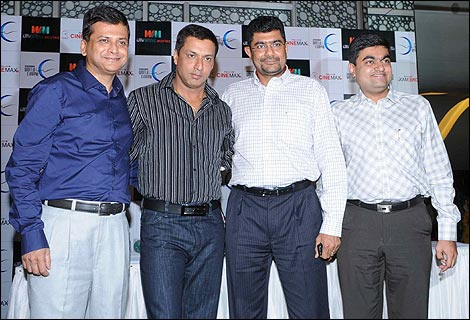 The Shemaroo personnel and director Madhur Bhandarkar pose for the media during the launch of Shemaroo's DVD releases.